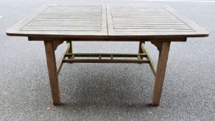 Wooden garden tableCondition ReportApprox. Dimensions 150 x 110 x 75cm Scratches throughout