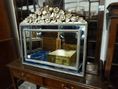 Two rectangular mirrors, one gilt framed, one silvered and moulded with fruit and flowers with a box