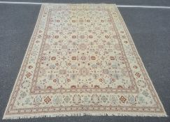 Kelim carpetdecorated allover with stylised flowerheads in blue, rust and green, on a cream ground,