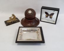 Turned hardwood bowling ballby Taylor Rolph Co Ltd, on turned oak stand and a exotic butterflyin