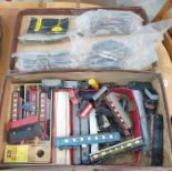 Suitcase and contentsof model railway accessories including a Trix Meteor Diesel Express set,