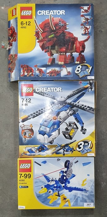 Three Lego sets including Lego Creator 4995, Creator 4892, Inventor 4090