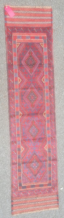 Meshwani runner, the central field with blue and red lozenges within multiple borders, 240cm x
