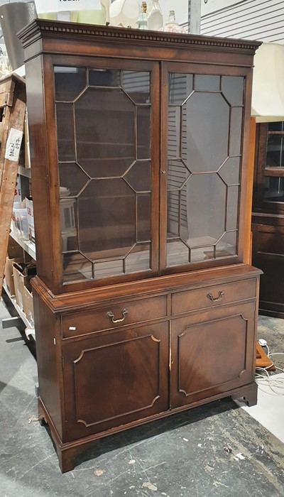 20th century bookcase cabinetwith moulded cornice above astragal-glazed doors enclosing shelves,