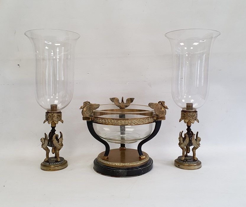 Modern metal garniturecomprising a pair of lamps supported by sphinxes with glass storm shades - Image 3 of 3
