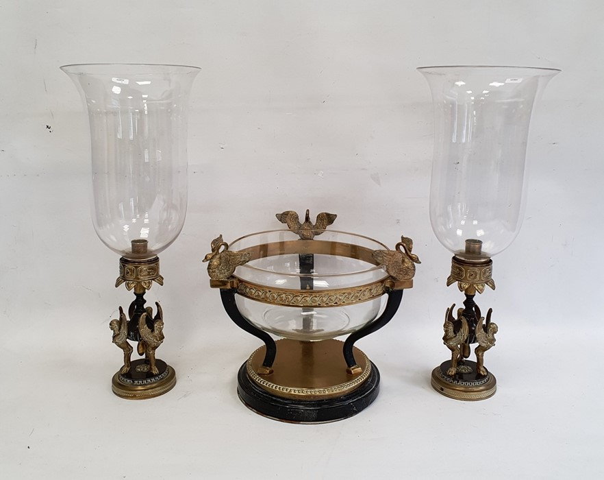 Modern metal garniturecomprising a pair of lamps supported by sphinxes with glass storm shades