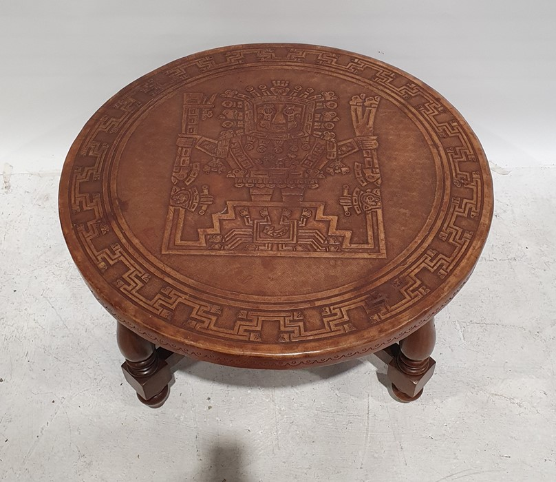 Circular coffee tablewith brown leather top with aztec design, on turned and block supports, - Image 2 of 2