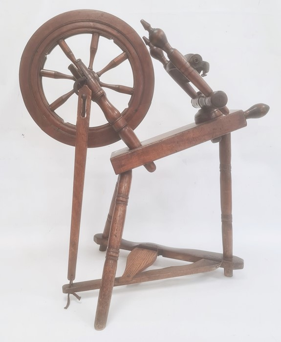 Turned wooden spinning wheel