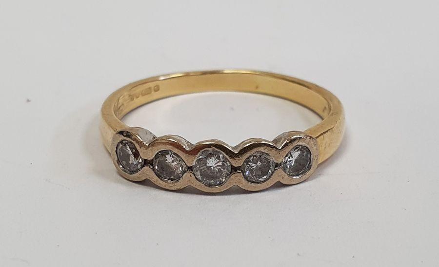 ****** Withdrawn********18ct gold five-stone diamond ring, the brilliant cut diamonds in rubover
