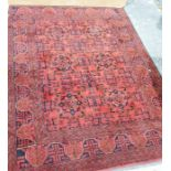 Rug, the central ground decorated with stylised flowerheads in cream and blue, within multiple