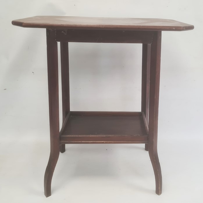 Early 20th century walnut two-tier side table, the rectangular top with canted corners, on shaped