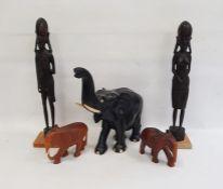 Large carved ebony modelof an elephant, 34cm high, two more carved hardwood models of elephantsand