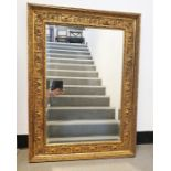 Rectangular mirrorwith bevel edged plate in moulded gilt-effect frame, 69.5cm x 96cm