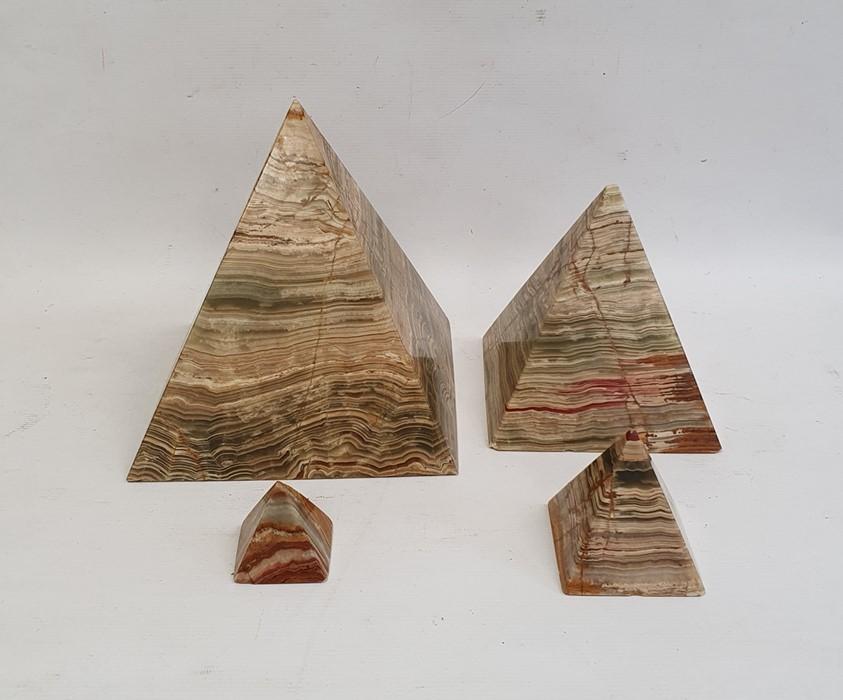 Set of three graduated hardstone pyramidsand one other, tallest 23cm high (4)