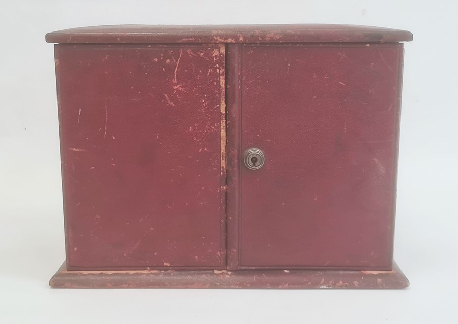 Victorian red leather travelling stationery case, the hinged cover and front revealing fitted