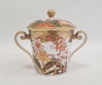 Spode two handled cup and cover, circa. 1820 of tapering form with scroll handles decorated in the