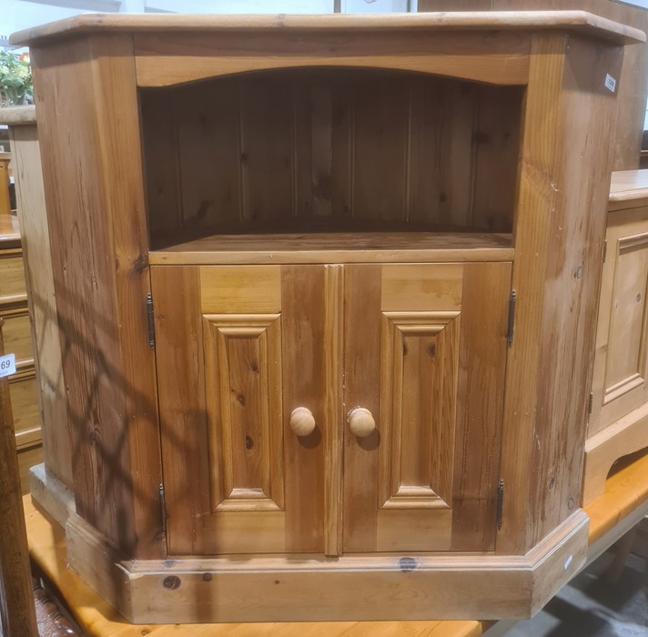 Pine corner low cabinetwith open tier above two cupboard doors, on plinth base, 84cm high