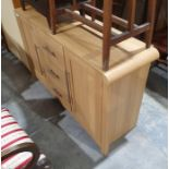 Modern oak-effect sideboard with three drawers, the central drawer flanked by cupboard door, on