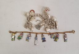 Silver curb link charm bracelet hung with ten assorted charms, some articulated, including a