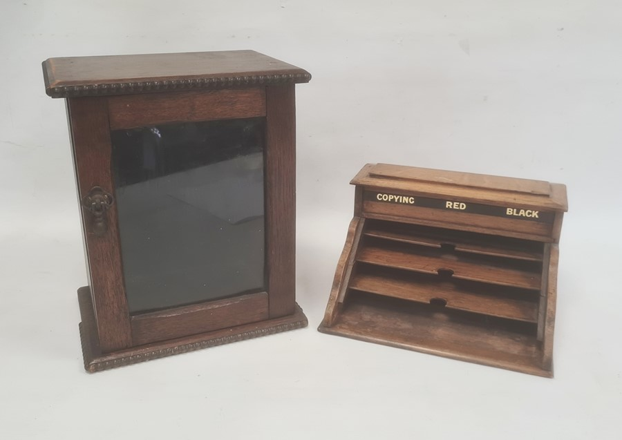 Early 20th century oak desk stationery organiser, the hinged cover with three ink wells for