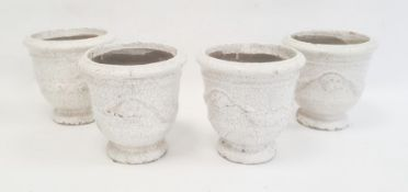Set of four jardinieres with moulded swag decoration and craquelure white glaze, 17cm high.