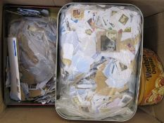 One box and contents of tins containing assorted stamps