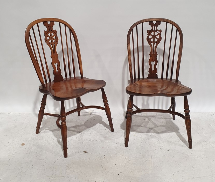 Set of eight 20th century elm seated wheelback chairs with crinoline stretchers, on turned