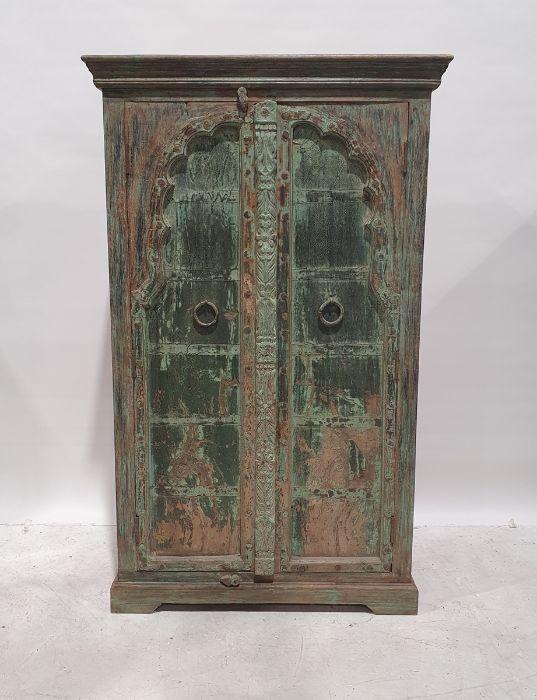 Two similar Eastern-style cupboardswith painted cupboard doors, on squat bracket feet (2)