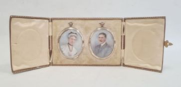 Pair of Edwardian portrait miniatures on ivorydepicting a lady and gentleman, signed with
