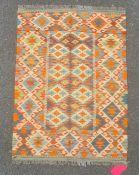 Chobi kilim rug in greens, oranges and blues on a cream ground, 116cm x 85cm.