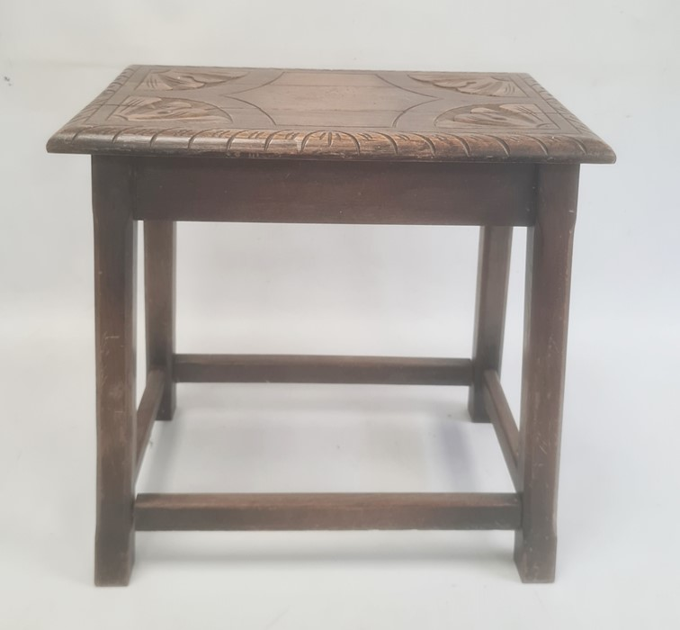 20th century joint-type stool, the carved top on chamfered supports, stretchered base, 45cm x 47cm