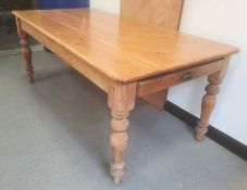 Pine kitchen table with rectangular top, on turned legs, 181cm wide