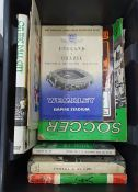 Two boxes of books and programmes relating to football including England v USSR at Wembley, December