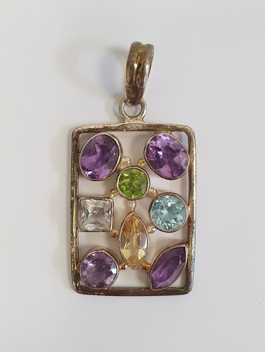 TGGC silver and semi-precious stone pendantof oblong openwork form and set eight variously cut