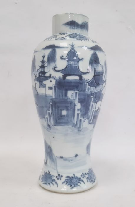 Chinese blue and white vaseof baluster form decorated with pagodas and lake scene, within a