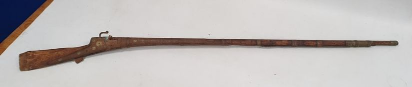 Old musketwith wooden stock and barrel and metal mounts