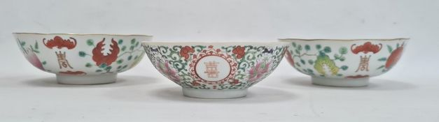 Pair of Chinese bowls, the exteriors with enamelled decoration of fruit, bats and character marks,