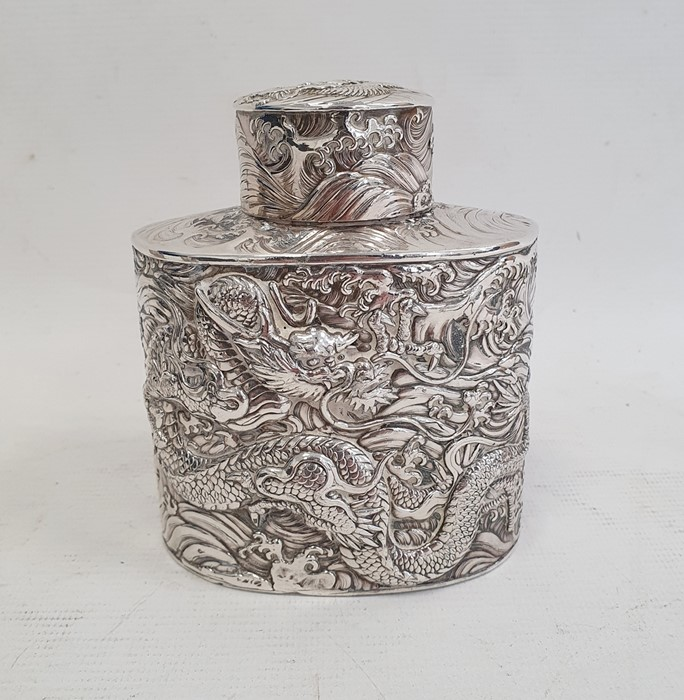 Chinese white metal tea canisterof oval form, decorated with dragons in relief, unmarked, 11cm high - Image 3 of 7