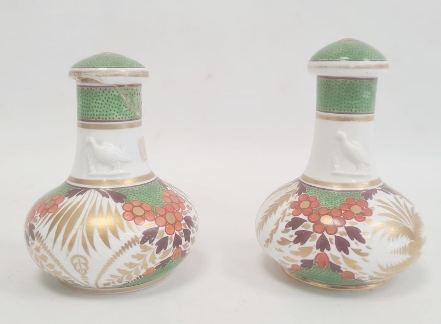 Pair of Spode bottles and covers circa. 1820, the necks with moulded decoration of a bird and the
