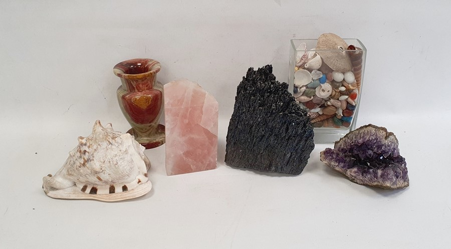 Amethyst geode, two further geodes, a turned hardstone vase, a conch shelland a vase of assorted