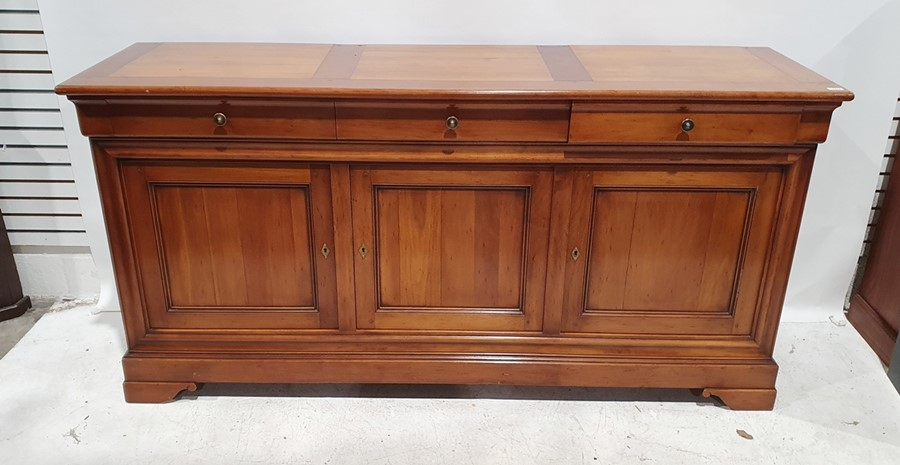 20th century modern cherry French sideboard, the rectangular top above three drawers, three cupboard