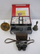 Cased mahjong set, a stellarscope(boxed) and a bell, and a pair Tourox 8x binoculars by J D Moeller
