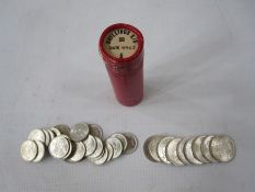 Tube of uncirculated or near-so shillings and sixpences, (24 sixpences and 10 shillings)