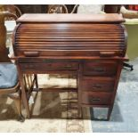 20th century Arts & Crafts style desk, the leather top with cut decoration, roll top, leather