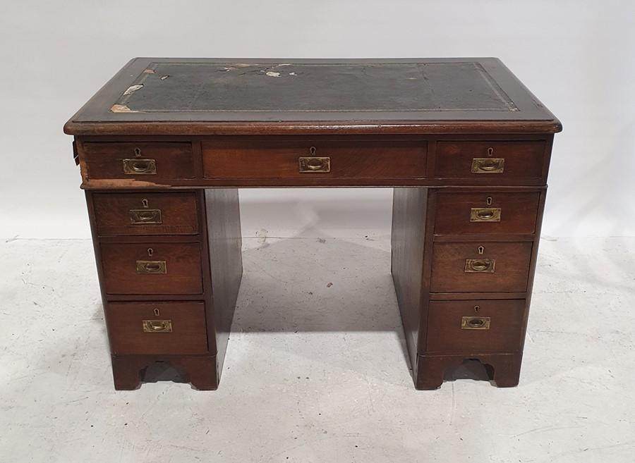 Campaign-style pedestal deskof nine drawers, leatherette top, moulded edge, on bracket feet, 101.