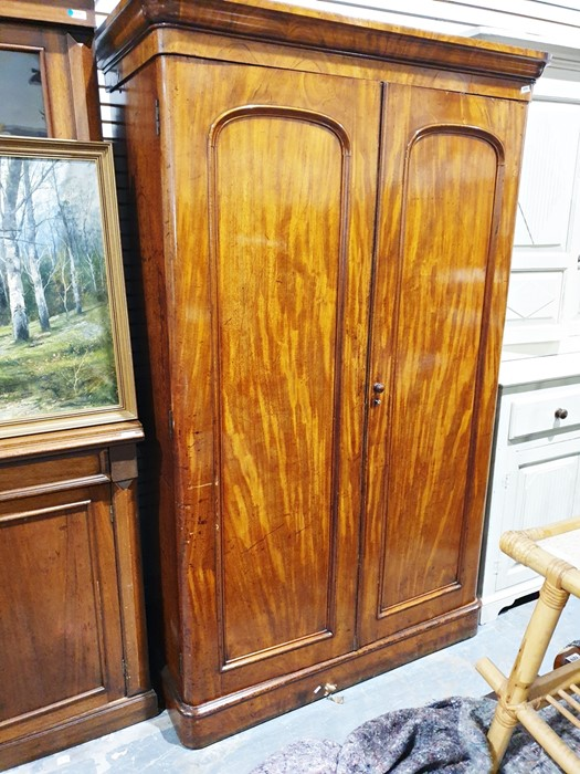 19th century mahogany converted wardrobe/shelving unit, the moulded cornice above two doors