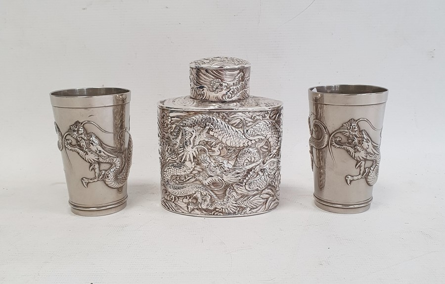 Chinese white metal tea canisterof oval form, decorated with dragons in relief, unmarked, 11cm high