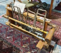 Wooden croquet stand fitted with four mallets by G Bussey & Co, a set of eight metal hoops, four