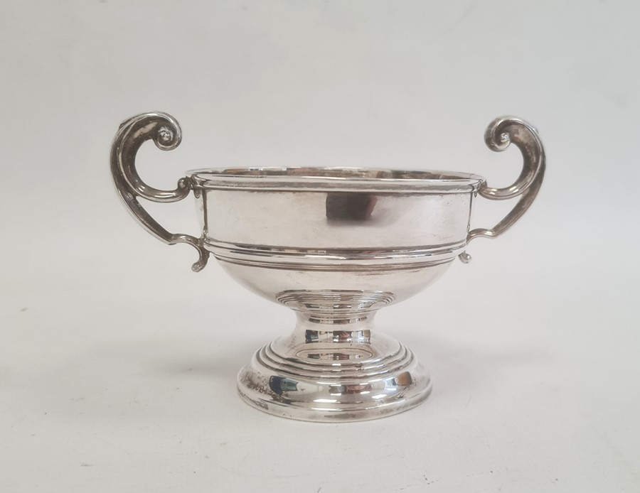 Silver two-handled pedestal bowlby J Boseck & Co, Birmingham 1911, of circular form with scroll