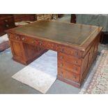 Edwardian oak partner's pedestal desk of large proportions, the rectangular gilt tooled leather